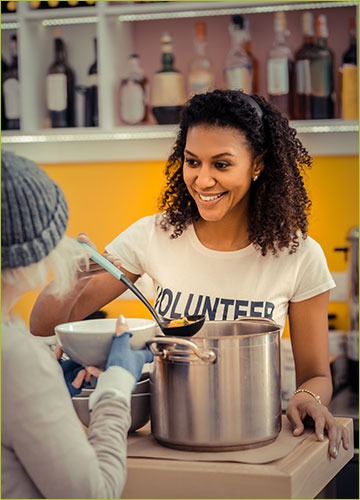Volunteer working at a soup kitchen